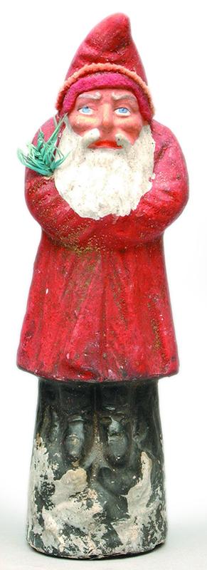 Figura de Belsnickel. Semella un nomo ou un San Nicolás, mais mantén a rama ou feixe para zorregar.