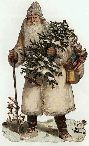 Imaxe do Juenmanden ou Yule Father coa súa característica árbore, desta vez vestido de branco.